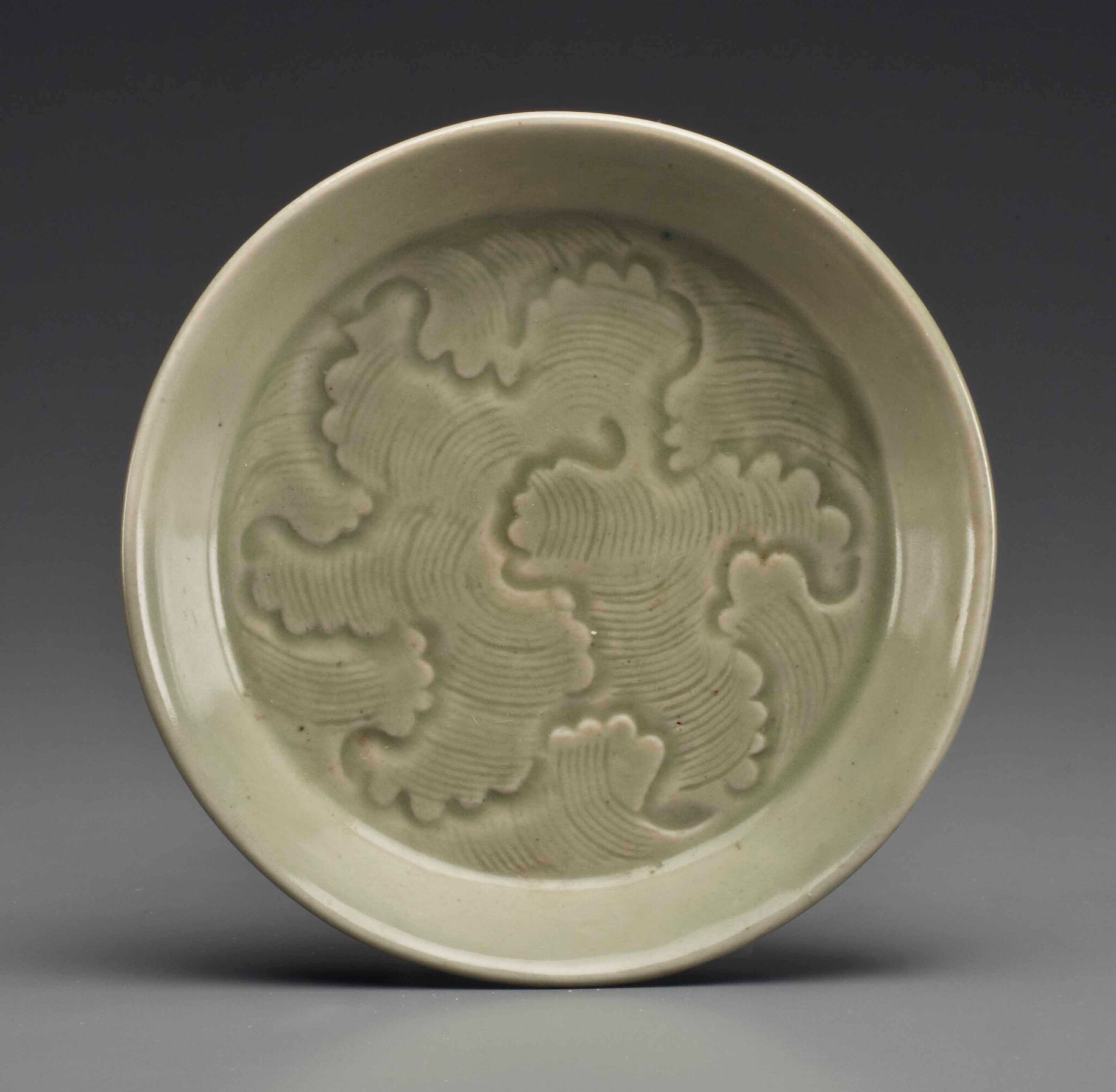 A small Yaozhou celadon carved saucer dish, Northern Song dynasty (960-1127)