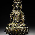 A parcel-gilt bronze seated figure of guanyin, late ming dynasty, 17th century