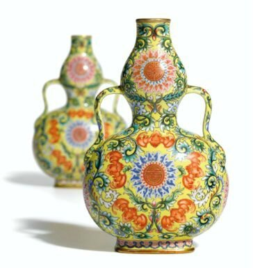 Yellow-ground famille-rose double-gourd vase, one of a pair, of Qianlong mark and period