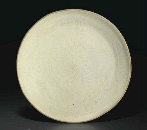 A Dingyao carved 'Lotus' dish, Northern Song dynasty (AD 960-1127)