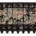 A rare twelve-panel carved lacquer screen, kangxi period (1662-1722)