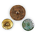 A rare gilt-bronze 'bear' circular plaque and two mirrors Warring States period - Han dynasty