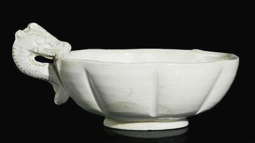 A rare'Huozhou' lobed 'Dragon' cup, Jin dynasty (1115-1234)
