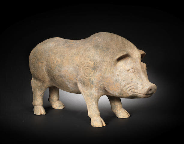 A large grey pottery figure of a pig, Han Dynasty (206 BCE-220 AD)