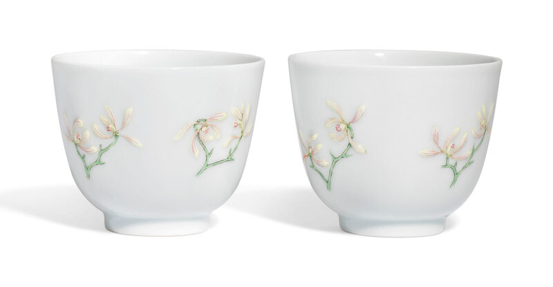 A rare pair of famille rose moulded 'Orchid' cups, Daoguang six-character seal marks in underglaze blue and of the period (1821-1850)