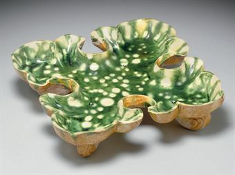 a_rare_resist_decorated_green_cream_and_amber_glazed_pottery_quatrefoi_d5347967h