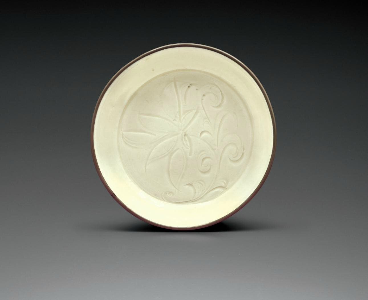 A small Dingyao carved dish, Northern Song dynasty, 11th-12th century
