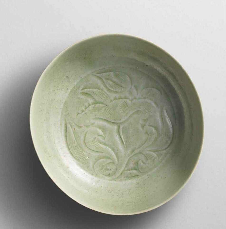 A Yue carved 'peony' washer, Five Dynasties (907-960)