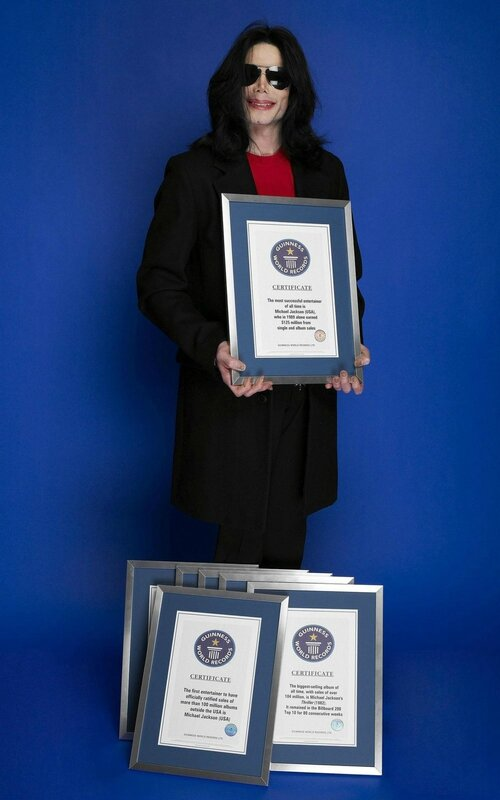 michael-poses-with-his-seven-guinness-world-records-awards(255)-m-1