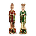 Two sancai pottery figures of officials, tang dynasty