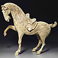 A painted pottery figure of a prancing horse, Tang dynasty (AD 618-907)