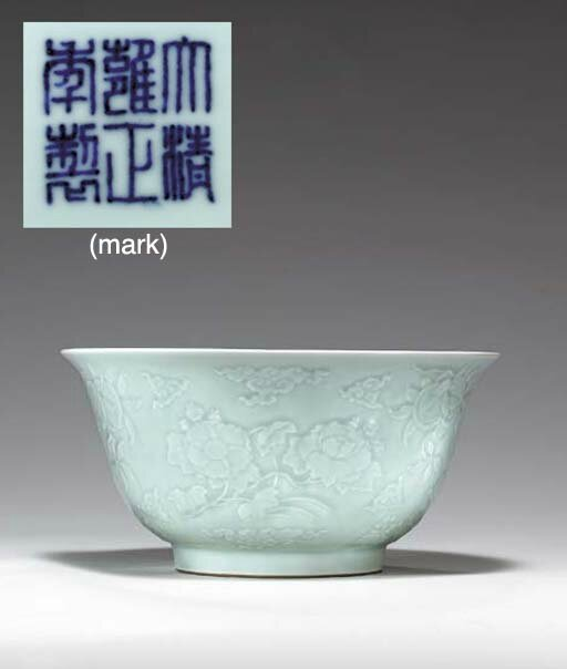 A rare large carved celadon bowl, Yongzheng six-character seal mark in underglaze blue and of the period (1723-1735)