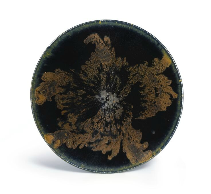 A 'Henan' russet-splashed black-glazed conical tea bowl, Song Dynasty (top view)