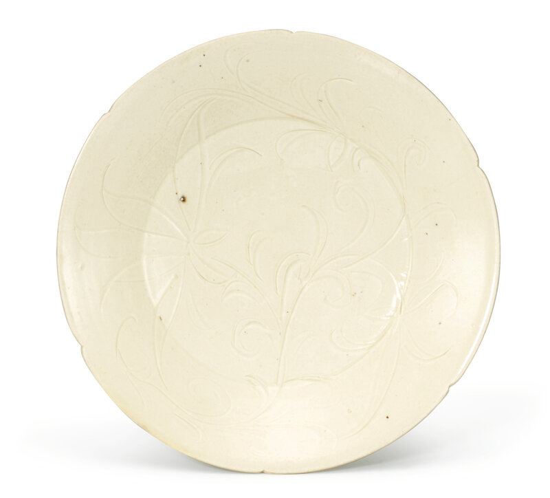 An incised Dingyao lobed 'Floral' dish, Song dynasty (960-1279)