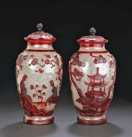 A_pair_of_red_overlay_glass_covered_jars
