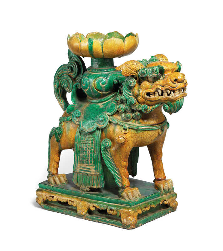 A large amber and green glazed tileworks 'Buddhist lion' stand, Ming dynasty (1368-1644)