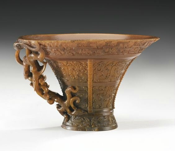 An Exquisitely Carved Archaistic Rhinoceros Horn Libation Cup, by Hu Xingyue, 17th-18th Century