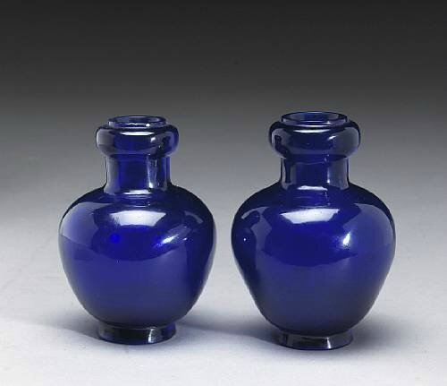 A pair of cobalt blue Peking glass vases. Qianlong Marks and Period.Photo Bonhams