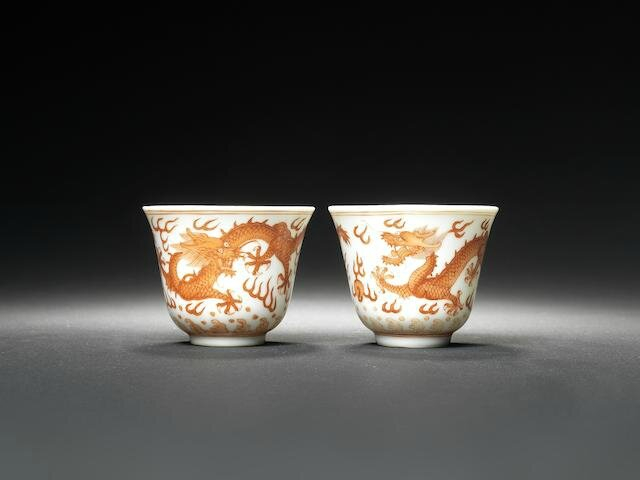 A pair of iron-red 'dragon' wine cups Guangxu six-character marks and of the period