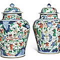 A pair of wucai 'hundred boys' jars and covers, 17th century