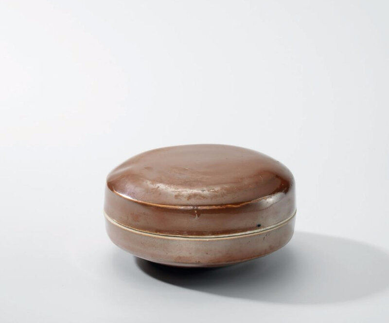 A Ding persimmon-glazed circular box and cover, Northern Song-Jin dynasty (960-1234)