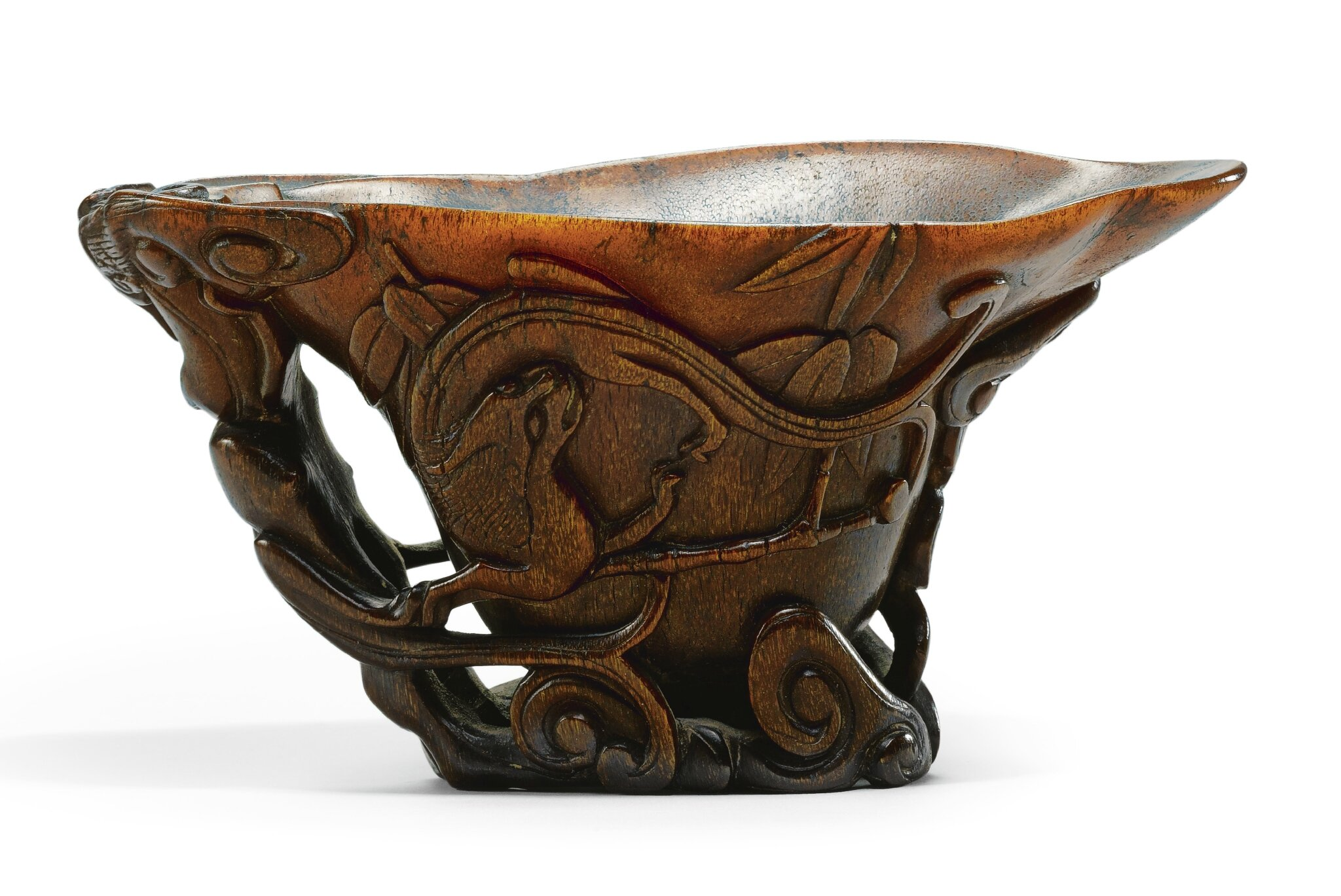 A carved rhinoceros horn 'chilong' libation cup, 17th century