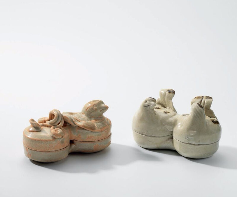 A Qingbai iron-spot 'Mandarin ducks' conjoined box and cover and a celadon iron-spot bird-form conjoined box and cover, Song dynasty (960-1279)
