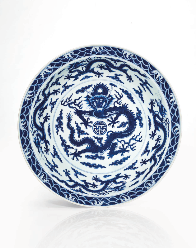A rare and important imperial blue and white 'dragon' dish, Qing dynasty, Qianlong six-character seal mark in underglaze blue and of the period (1736-1795)