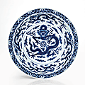 A rare and important imperial blue and white 'dragon' dish, qianlong six-character seal mark and of the period (1736-1795)