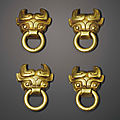 A set of four miniature gold mask-form handles, eastern zhou dynasty (770-256 bc)