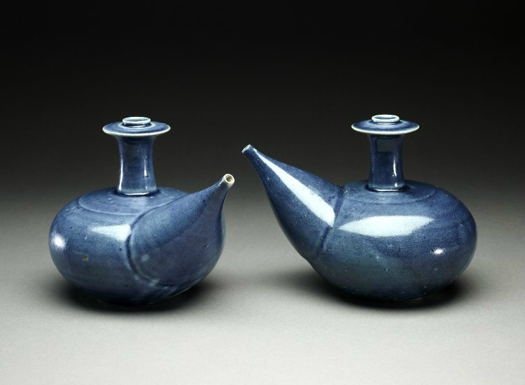 Monochrome blue kendi or ewers. Made of blue glazed stoneware. Vietnam,1450-1480. Height: 14.1 centimetres. The Hoi An Ship,shipwreck. Brooke Sewell Permanent Fund. 2000,1212.2 & 2000,1212.3. British Museum © The Trustees of the British Museum.