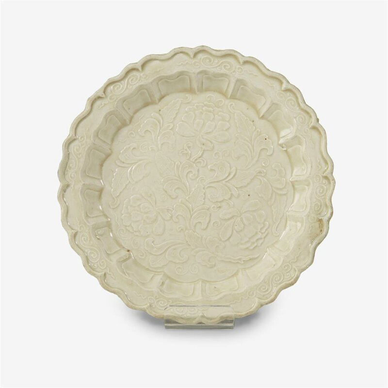 A Chinese moulded 'Ding' 'peony' dish, Northern Song dynasty (960–1127)