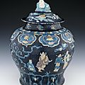 Porcelain wine jar and cover with incised and 'fahua'-type decoration, Ming dynasty, circa 1488-1522
