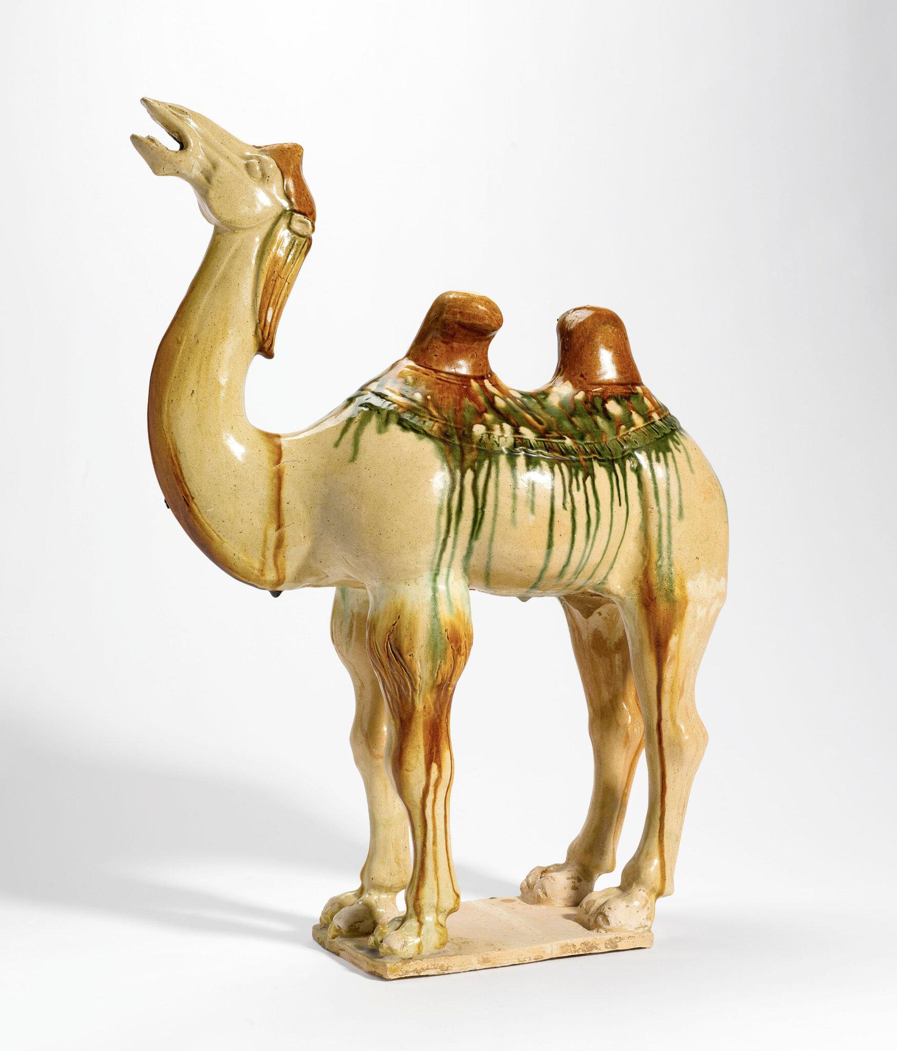 A 'sancai'-glazed pottery figure of a Bactrian camel, Tang dynasty (618-907)