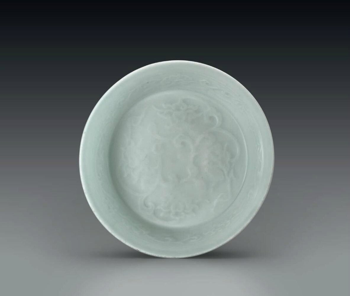 A molded shufu shallow bowl, Yuan dynasty (1279-1368)