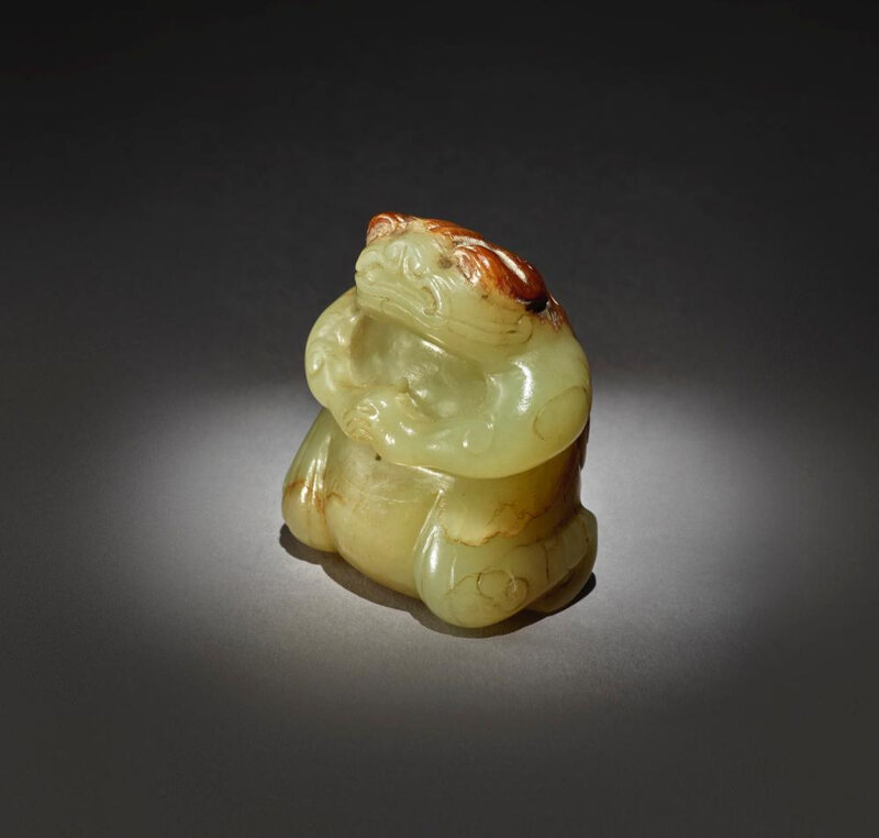 An exceptionally rare yellow and russet jade figure of a mythical toad, Six Dynasties