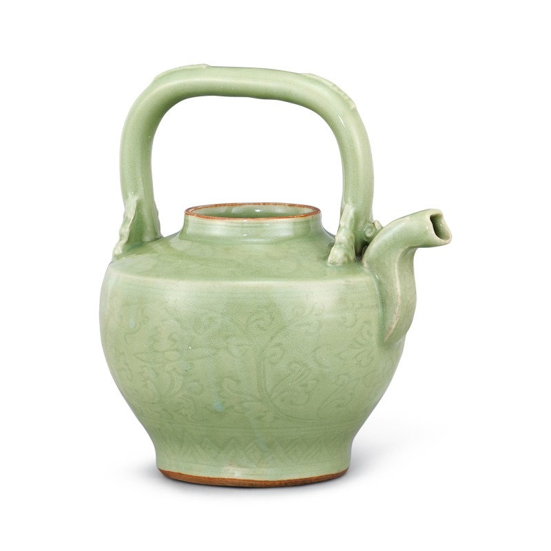 A Longquan celadon carved 'floral' wine ewer, Ming dynasty (1368-1644)