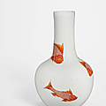 A rare moulded iron-red and gilt-decorated 'fish' vase, tianqiuping, yongzheng period (1723-1735)