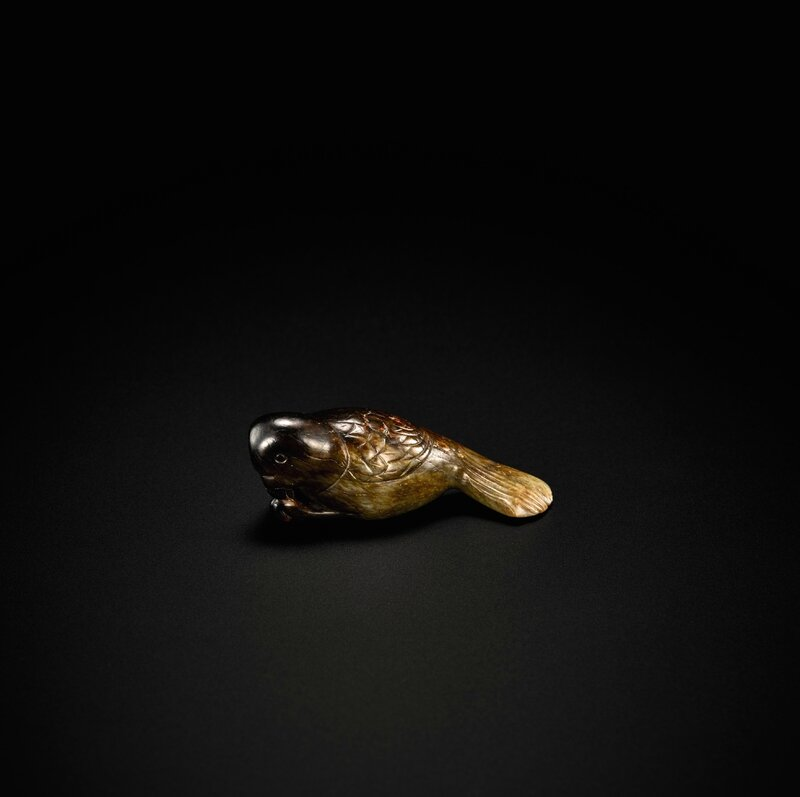 Lot 30_A MOTTLED BROWN JADE CARVING OF A PAROT SONG - MING DYNASTY