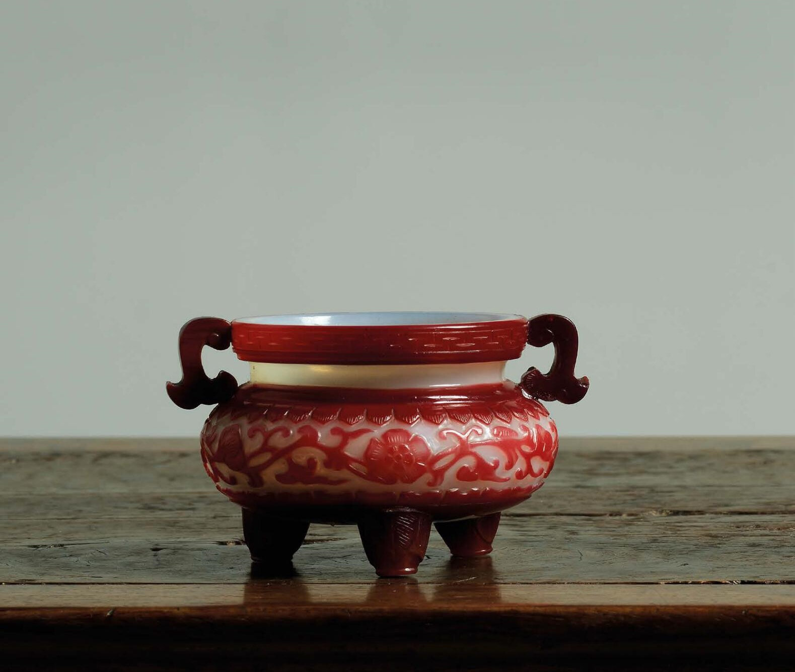A Very rare Imperial ruby-red overlay white glass censer, Qianlong incised six-character mark in a line and of the period (1736-1795)