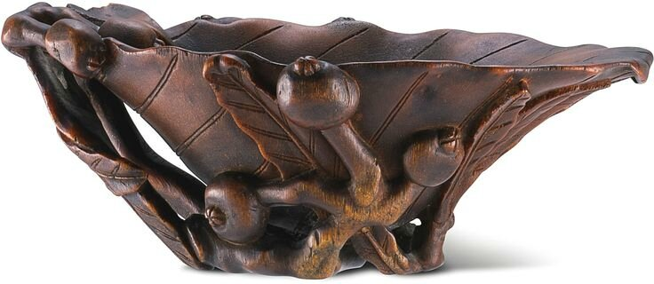 A carved rhinoceros horn 'Rose hip' libation cup, Qing dynasty, 17th-18th century