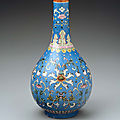 Long-necked ovoid vase with floral scroll over blue ground, Qing dynasty, Qianlong seal mark and period (1735–96), Jingdezhen ware; porcelain with overglaze enamel decoration, 25.4 cm (10 in.). Gift of Barbara D. Danielson, 1980.497 © 2018 Museum of Fine A