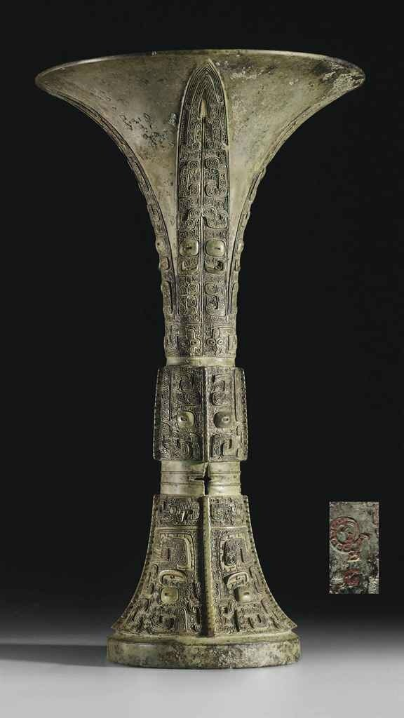 A finely cast bronze ritual wine vessel, gu, Shang dynasty, Anyang, 12th century BC