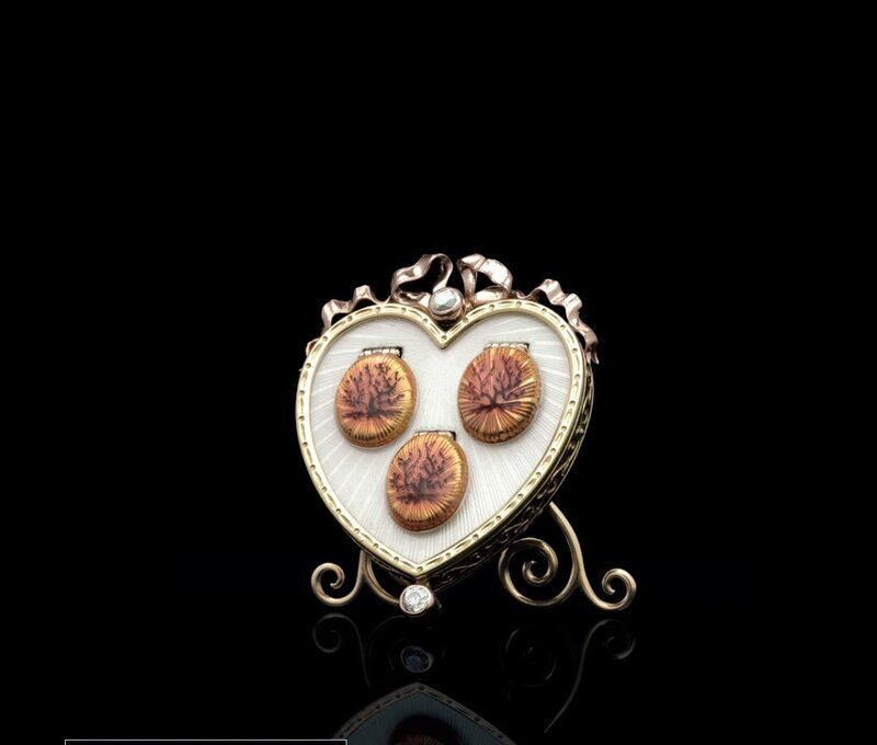 A Rare and Important Jeweled Gold and Guilloché Enamel Photograph Frame Marked Fabergé