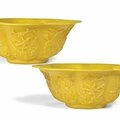 A pair of Chinese yellow glass lobed bowls, 19th-20th century
