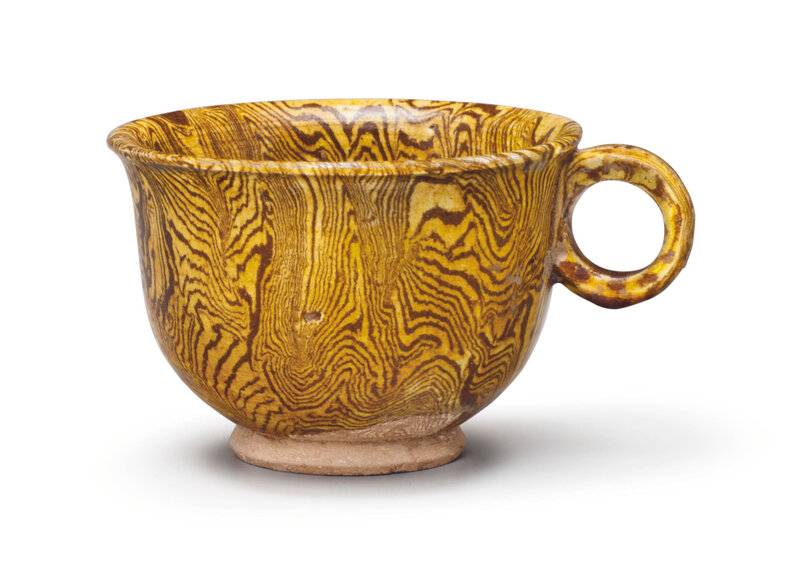 An amber-glazed marbled pottery cup, Tang dynasty (618-907)