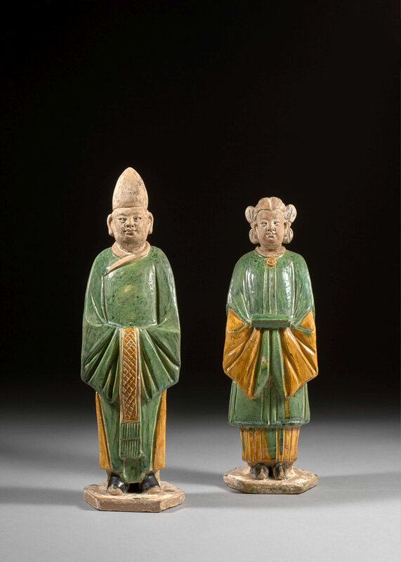 Two green, yellow and cream glazed pottery figures, Ming dynasty, 17th century