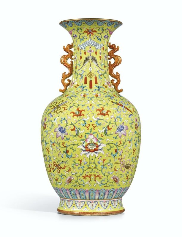 A magnificent and monumental yellow-ground famille-rose 'Anbaxian' sgraffiato vase with dragon handles, seal mark and period of Qianlong