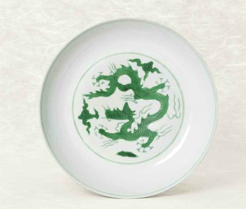 A fine and rare incised green-enamelled 'Dragon' dish, Hongzhi six-character mark within double circles and of the period (1488-1505)