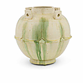 A green-glazed 'lotus-petal' jar, guan, Tang Dynasty (618-907)